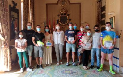 Los ganadores del I Circuito de Carreras Virtuales REcorre reciben sus premios